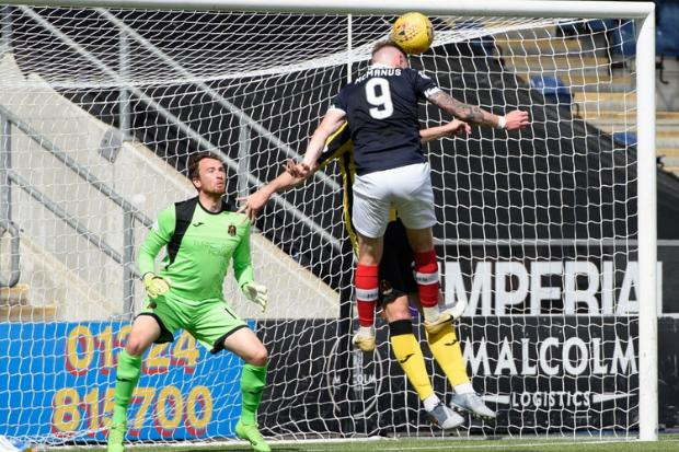 Declan McManus rises above Ryan McGeever to nod home Falkirk's second (Photo: falkirkfc.co.uk)