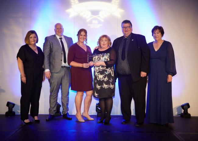 Some of the team receive their award from Jane Grant, chief executive of NHSGGC, right
