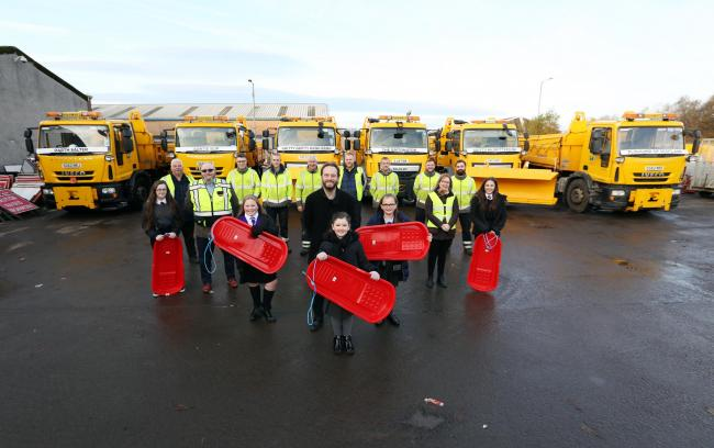 Winners pictured with councillors and the gritting teams