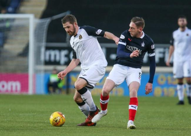 Kyle Hutton powering away from Falkirk double hero Declan McManus (Photo: Andy Scott)