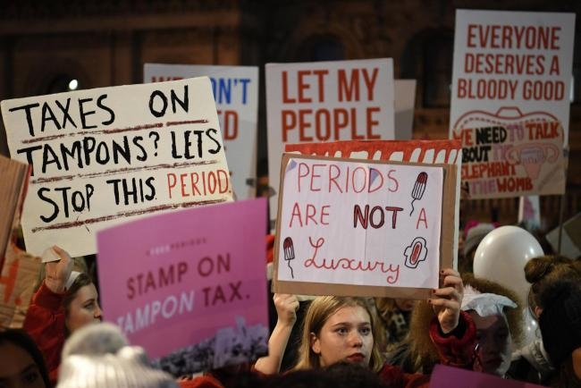 People gather during a Period poverty protest opposite Downing Street in Whitehall, led by Free Periods, a group which is asking for free sanitary products for all girls on free school meals. The protest features speeches from among others.