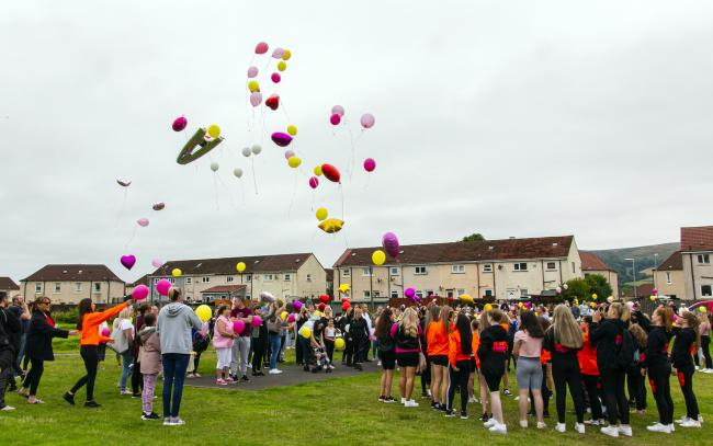 Balloons were released from Dalmonach Park in Old Bonhill on Saturday in memory of Ava Gray (Photo - Tom Watt)