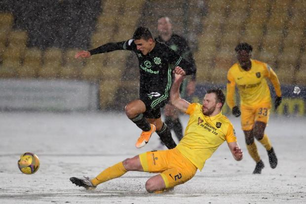 Livingston's Nicky Devlin, seen here challenging Mohamed Elyounoussi of Celtic in a Premiership clash in January, will line up against St Johnstone in the Betfred Cup this weekend - 11 years after making his debut at senior level for Dumbarton in a