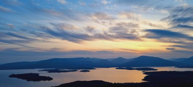 Watching the sun setting from Conic Hill by Nicola Campbell