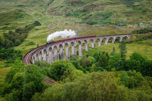 Dumbarton and Vale of Leven Reporter: View of a steam train on a famous Glenfinnan viaduct, Scotland; Shutterstock ID 154641122; PO: THE HERALD MAGAZINE ; Job: TRAVEL