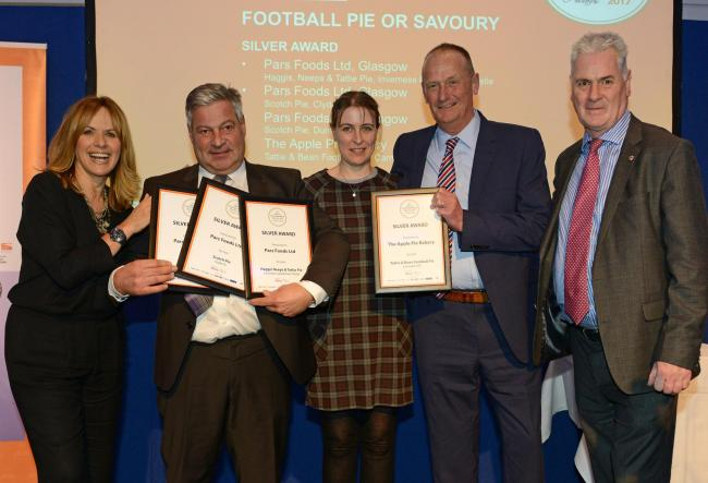 Representatives of Pars Foods celebrate with organisers, other award winners and TV presenter Carol Smillie
