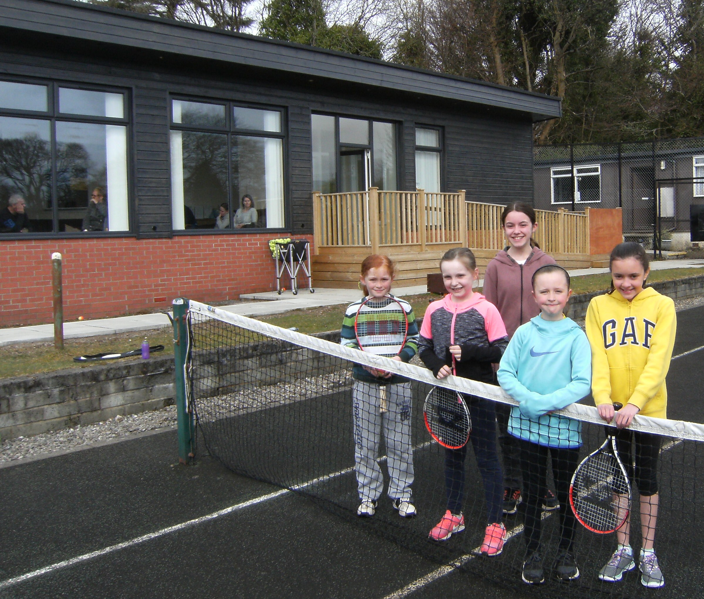 Youngsters at a junior coaching session at Kirktonhill Tennis Club