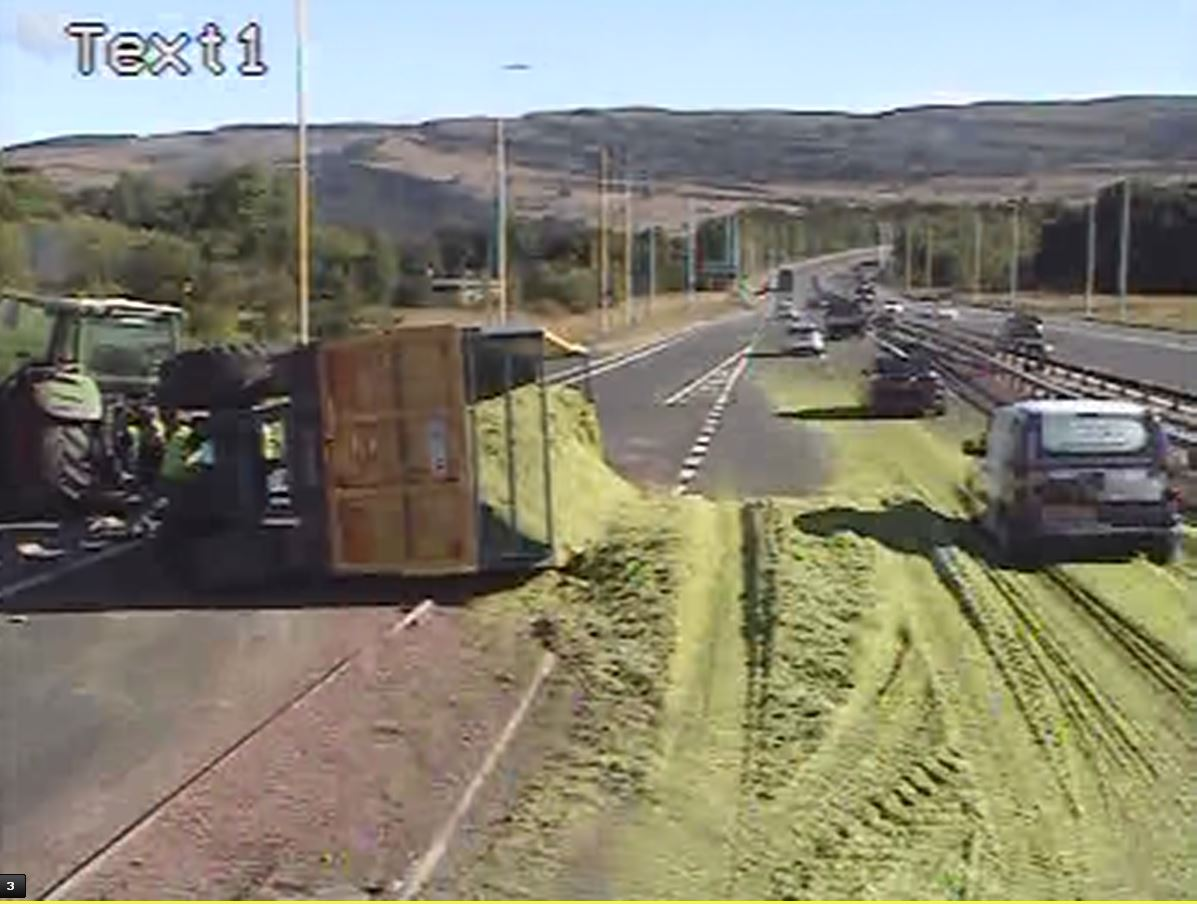 This Traffic Scotland images shows the grass spillage over the carriageway