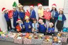 Pupils at Balloch Primary with their donations in bags which the food bank says was a great help as they're often short of bags