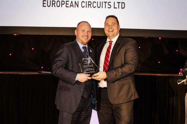Philip Briscoe of European Circuits receiving the Business of the Year Award from Colin McMurray of Clyde Marine Training