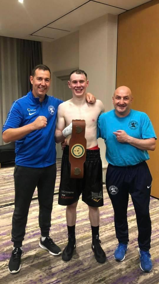 Martin Harkin with his new Celtic title alongside trainer Danny Lee, left and coach Grant McAuley, right