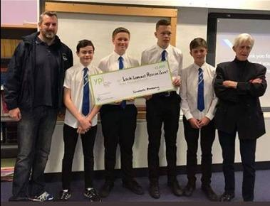Pupils hand over their cheque for £3,000